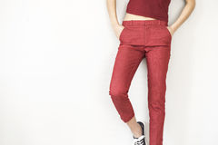 Woman in red pants and shirt Stock Images