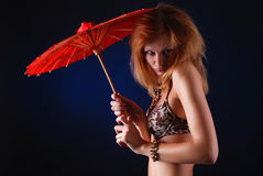 Woman with red parasol Royalty Free Stock Image