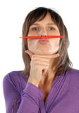 Woman with red pencil. As a symbol for reductions Stock Photography