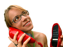 Woman with Red Phone. Attractive young woman wearing eyeglasses and holding red phone royalty free stock image