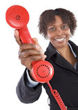 Woman with a red phone Stock Photo