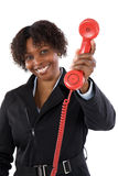 Woman with a red phone Royalty Free Stock Photos