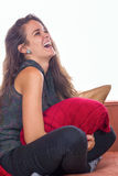 Woman with red pillow stock photo