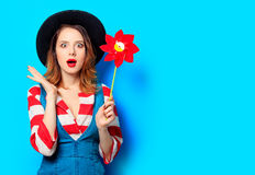 Woman with red pinwheel Stock Photo