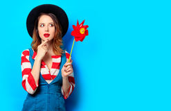 Woman with red pinwheel Royalty Free Stock Image