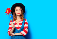 Woman with red pinwheel Royalty Free Stock Photography