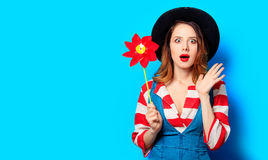 Woman with red pinwheel Stock Photos
