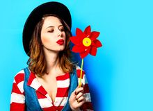 Woman with red pinwheel stock image