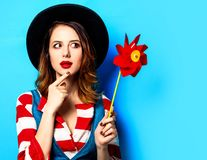 Woman with red pinwheel stock photos