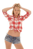 Woman red plaid shirt shorts hands hair Royalty Free Stock Photo