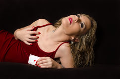 Woman in red with playing card Royalty Free Stock Images