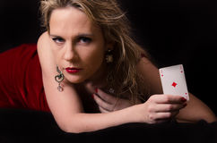 Woman in red with playing card Stock Photos