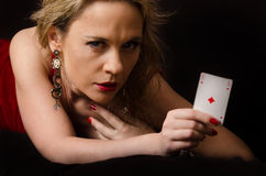 Woman in red with playing card Stock Photography