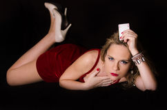 Woman in red with playing card Royalty Free Stock Image