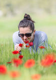 Woman with red poppies Stock Photo