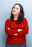 Woman in Red Posing With Hands Folded Stock Image