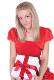 Woman in red with present Stock Image