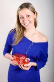 Woman with a red present gift Royalty Free Stock Images