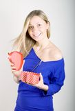 Woman with a red present gift Stock Photos