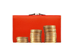 Woman red purse (wallet) and golden coins isolated on white Royalty Free Stock Photo