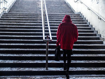 Woman in red raincoat on stairs Royalty Free Stock Image