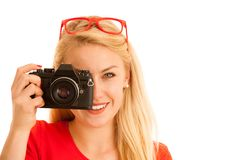Woman in red with a retro camera isolated over white background Stock Images