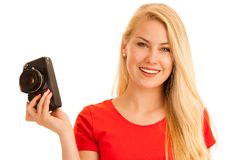 Woman in red with a retro camera isolated over white background royalty free stock photo