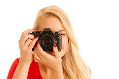 Woman in red with a retro camera isolated over white background.  stock photos