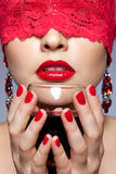 Woman in red ribbon and wine Royalty Free Stock Images
