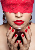 Woman in red ribbon and wine Royalty Free Stock Photo