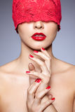 Woman in red ribbon Royalty Free Stock Image