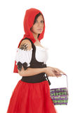 Woman red riding hood basket looking. A woman with a serious expression on her face holding on to her basket with her wolf paw tattoo stock images