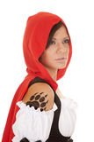 Woman red riding hood claw tattoo. A woman in her red hood looking away with her paw print tattoo on her shoulder stock photos