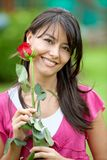 Woman with red rose Stock Photography