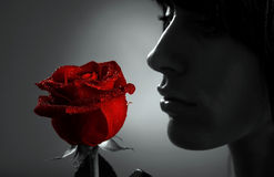 Woman with red rose stock photo