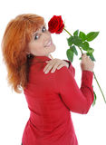 Woman with a red rose. Royalty Free Stock Image