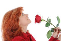 Woman with a red rose. Red-haired woman with a red rose. Isolated on white background Royalty Free Stock Images