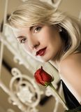 Woman with a red rose Stock Image