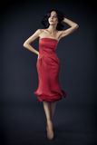 Woman In Red Rose Dress On Dark Royalty Free Stock Photo