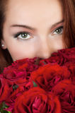 Woman with red roses Stock Image