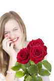 Woman with red roses.GN. Happy Young woman standing behind a bouquet with red roses.GN stock image