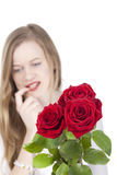 Woman with red roses.GN. Happy Young woman standing behind a bouquet with red roses.GN stock photos