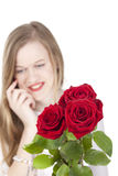 Woman with red roses.GN. Happy Young woman standing behind a bouquet with red roses.GN royalty free stock photos