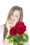 Woman with red roses.GN. Happy Young woman standing behind a bouquet with red roses.GN royalty free stock images