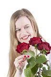 Woman with red roses.GN. Happy Young woman holding a bouquet with red roses.GN stock images