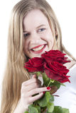 Woman with red roses.GN. Happy Young woman holding a bouquet with red roses.GN royalty free stock images