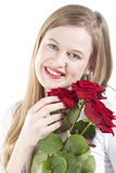 Woman with red roses.GN. Happy Young woman holding a bouquet with red roses.GN royalty free stock photos