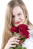 Woman with red roses.GN. Happy Young woman holding a bouquet with red roses.GN royalty free stock image