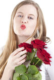 Woman with red roses.GN. Happy Young woman holding a bouquet with red roses.GN stock photography