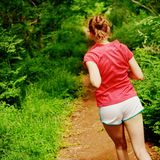 Woman In Red Running Stock Images